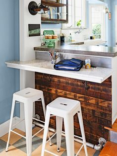 great kitchen bar with reclaimed wood - and don't miss that footrest made from plumbing pipes!