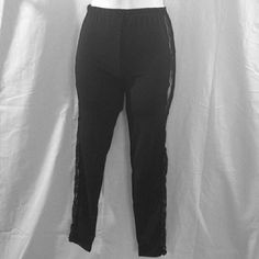 NWT Black Side Floral Lace Leggings This is a gorgeous pair of leggings that were only taken out of the package to take pictures! They are solid black and have sexy, black floral lace all the way down each side.  These are one size, but best fit is for xs-medium.  These leggings are a must have! #nwt #new #leggings #black #lacesidecutouts #lace #floral #onesize Pants Leggings