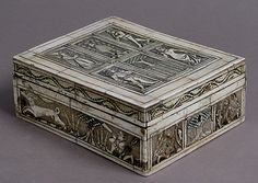 Game Box,15th century.French. Bone,traces of gilding and paint over wooden core with red silk interior,metal mounts.