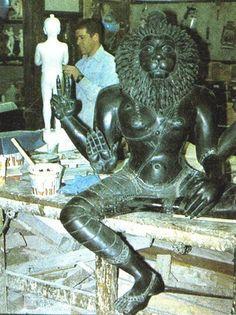White boy sculpting deities of Narasingh and Prahlada