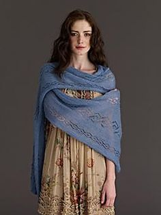 Knit this beautiful wrap with a diamond lace pattern throughout, designed by Vickie Glynn and using the beautiful yarn Fine Lace, is a must have for any occasion.