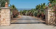 Automatic gate openers and automatic gate opener repair pros servicing San Antonio, Kingwood, Katy, Sugar Land, and The Woodlands TX.