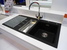 Black kitchen sink with chrome kitchen taps