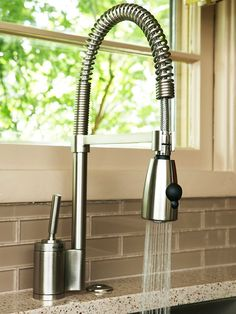 High-Function Fixtures        Increased space, expanded countertops, and better appliances make for a highly functional kitchen. Here, a powerful sprayer faucet includes pro-style amenities in this kitchen. With a pause button and pullout capabilities, the sprayer easies food prep and keeps cleanup quick.