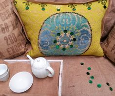 Moorish themed pillow.  Citron green needle point with recycled Burlap and a new chenille fabric Medallion hand stitched on and Sequins.