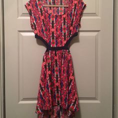 ⚡️SALE! ⚡️Tribal cut-out midriff mini Never-been-worn printed dress with cut outs at waist and in back - elastic back. Love this dress but it was a little too snug on me! Size large, but fits more like a curvy medium! Dresses Mini