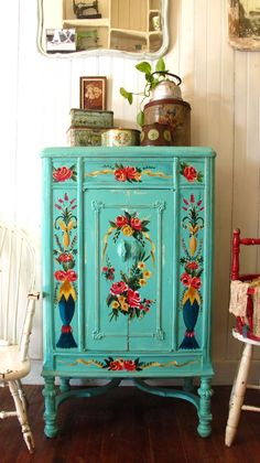 Beautifully painted cabinet in a Boho Gypsy style using Turquoise, Yellow and Orange-Red as the main feature colours.