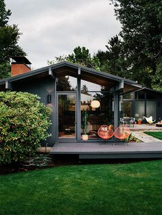 Midcentury-modern house with dark exterior