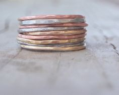 Stacking Skinny Rustic Rings Silver Gold Copper Rings NINE Stacking Hammered Brushed Soldered Delicate Simple Rings Chic Spring Fashion. $63.00, via Etsy.