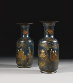 A PAIR OF BLUE LACQUERED EARTHENWARE VASES, IN THE MANNER OF MARTIN SCHELL, POSSIBLY GERMAN, EARLY 19TH CENTURY each of baluster form with a flared neck, the body painted with Chinese figures in a landscape amidst reserves of chrysanthemums, dragons and Chinese motifs, the rear with an exotic bird, the whole decorated in parcel-gilt, coral and silver on a royal blue ground each 88cm