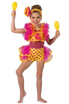 Style#  17151 MAMA LOVES MAMBO  Yellow/pink polka dot printed spandex short unitard with multi-color sequin on pink mesh inserts. Attached raspberry chiffon bustle and sleeves. Ribbon and chiffon pouf trim. Headpiece included. XSC-XLC A81/721-Yellow plastic maracas, optional.