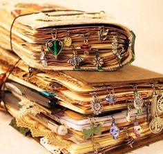 Book jewelry for junk journal travelers notebooks... better than ice cream :-) . . #journal #junkjournal #junkjournaljunkies #journallove #journalmaking #vintageimages #vintagestyle #teadyed #handmadejournal #handmadebooks #teaandbooks #journalwithme #journaladdict #instajournal #instaetsy #etsyshop #etsyseller #etsyfinds #craftideas #artjournal #instartist #mrscogscrafts #travelersnotebook #bookbling #charms