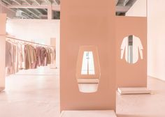Snarkitecture used pink-hued steel and floor-to-ceiling mirrors for a COS pop-up store in LA.