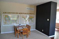love this homeschooling room complete with maps, letters, and chalkboard wall!