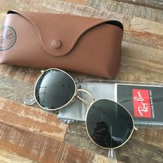 """Ray Ban """"John Lennon"""" sunglasses Brand new Ray Ban sun glasses. Never worn outdoors. Comes with all original packaging including cleaning cloth! Ray-Ban Accessories Sunglasses"""