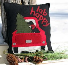 You will enjoy This Christmas Pillow with its classic Red Truck and Happy Lab who helped cut the familys Christmas Tree. You can make it out of Christmas and winter time colors from your wool fabric scraps or we have the complete wool fabric kit for this pillow for sale in our store, here; https://www.etsy.com/listing/267642239/fabric-only-for-the-lab-happy-pillow?ref=shop_home_active_1  Pattern comes with full size design, color picture and easy to follow instructions. Finished size of the…