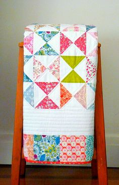 from Red Pepper Quilts...like the colorful border to match the design inside & i like the thick white border too