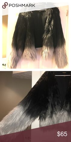 Torrid empire size 4 Torrid empire collection faux fur black to grey ombré coat. Perfect condition!!! Size 4 but fits sizes 2-4. Still selling online for $85 torrid Jackets & Coats