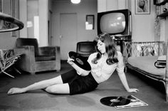 Marie-France Pisier enjoying some records