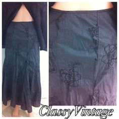 Charcoal grey tulip skirt Shimmering charcoal grey skirt that has contrasting embroidered design throughout. The fabric has a shimmering look to it. Tag size 8 but I think it runs a bit big. Side zipper. Waist 35, length 36 inches. This is lined.100% cotton. No give no stretch. tribal Skirts