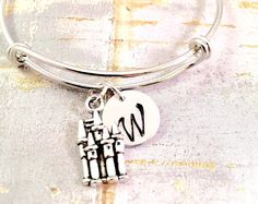 Fantastic Beast / Harry Potter bracelet - a 3 D Dragon charm, a 2-Sided Castle charm, and Harry Potter Symbol charm on a stainless steel adjustable bangle bracelet. Designer inspired...  A great gift for the Harry Potter fan in your family, or your bestie.... an expandable stainless steel bangle bracelet makes the perfect gift for that SPECIAL SOMEONE! THIS BRACELET LISTING is as shown - All charms are antique silver.  The bangle bracelet fits a wrist sized 6-8. See photo for charm sizes…