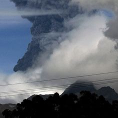 Ecuador's President Rafael Correa said Saturday he would declare a state of emergency as the Cotopaxi volcano spewed ash into the sky, prompting evacuations of several nearby villages.