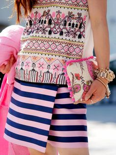 This girl has balls and isn't afraid to swing em! She has clashed patterns in a way that almost doesn't  work but by cleverly keeping the theme of the outfit summery she nails it! It is a pink explosion but to keep this look less erratic stick to a simple clutch....go on.....try it! x