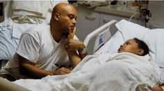 A Queens couple celebrated a unique wedding anniversary in a Long Island hospital Tuesday, insisting their love helped conquer a near fatal brain A Queens couple celebrated a unique wedding anniversary in a Long...