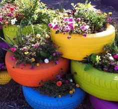 gardens-tire-planters Finally a use for old tires. Someone was resourceful. It would even be cute to use painted tires for when you plant potatoes! IF you plant potatoes LOL Old Tire Planters, Garden Planters, Diy Planters, Planter Ideas, Outdoor Planters, Planter Boxes, Outdoor Decor, Outdoor Ideas, Decorative Planters