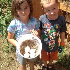 FAMILY FARM DAY on the IFFS Teaching Farm!! Collecting eggs is very important and these two little farmers did a great job!! #FoodShuttleGrows
