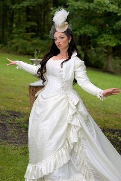 ivory Victorian steampunk wedding gown and a hat with a veil