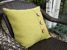 Pillow with handcrafted wooden buttons