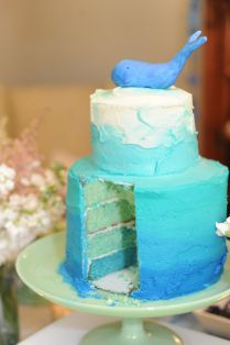 Tiered ombre whale baby shower cake