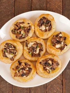 Mushroom and Goat Cheese Pastry Bites: An easy appetizer recipe of puff pastry cups filled with sautéed mushrooms, shallots and goat cheese that can be made in advance and reheated just before serving.