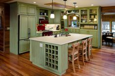Be bold and install (or paint) cabinets in your favorite color. Here, a rustic treatment ensures that the green doesn't overwhelm the space. Project completed by Neil Kelly  - GoodHousekeeping.com