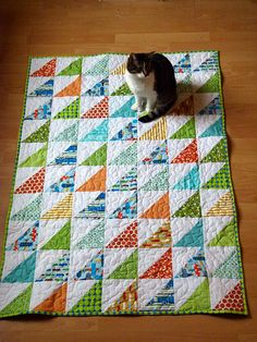 HST Baby Quilt. Typical cat, mine loves to roll in the fabric while i'm laying out the pattern.                                                                                                                                                      More