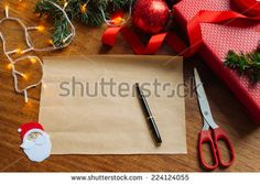 Blank sheet of paper on the table with Christmas decorations - stock photo