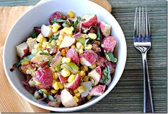Roasted potato - sweet corn salad  2 1/2 lb. unpeeled red potatoes, diced into 1/2-inch cubes1 medium red onion, thinly sliced2 Tbsp canola oil  1 1/2 cups sweet corn1 cup diced celery2 tsp. garlic powder1/3 cup extra-virgin olive oil1/3 cup apple cider vinegar3/4 cup thinly sliced fresh basilSalt and pepper, to tasteCooking spray