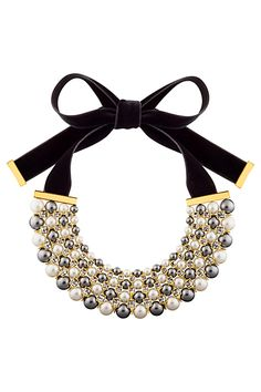 An intriguingly bold statement piece by Louis Vuitton.  The luxurious black velvet ribbon, stones and gold accents highlight the pearls to absolute perfection.