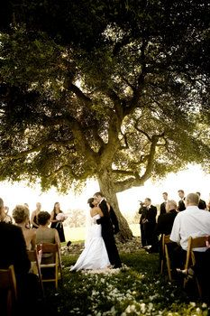 ...always wanted to get married under a big tree at sunset with tons of candles and flowers and touchstone of butterflies everywhere......maybe one day.