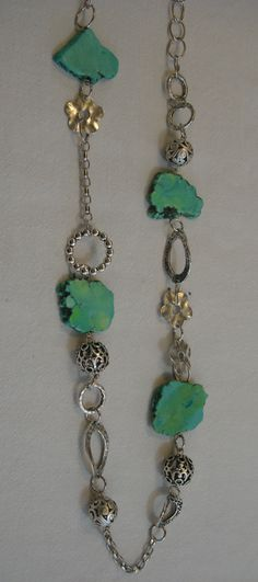 Long necklace with howlite and mixed metals by Razelle Troester