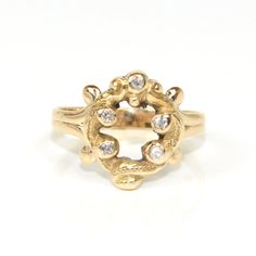 This beautiful antique diamond ring has a wonderful and unusual design. This is a great right hand ring. This ring is very old. It is from the