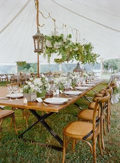 Lanterns. sisal rope, and hanging floral arrangements for a classic East Coast wedding! Photo: Kate Headley / Event Planning & Design: Pineapple Productions / Floral Designs: Dragonfly Events | Snippet & Ink