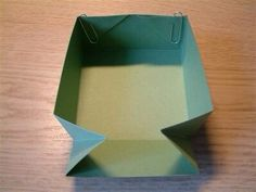 Fold in the corners to create a lid and glue them together, using paper clips to hold the glue until stuck