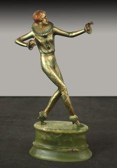 A Lorenzl Art Deco bronze harlequin dancer, Vienna 1930s.