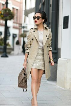 Winter is here! Trench coat time. So a beige/pearl coloured trench coat paired with a simple light grey t-shirt and a cute gold grey sparkle tube skirt or mini. A bag, sunnies and cute bun.