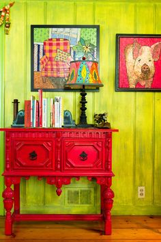 It may not be emerald, but the texture that painting the panelled wall creates is to die for! I love the contrasting colors and the simple bits of bright green throughout the paintings. This could definitely be done in a nice emerald hue with some cream, browns, or blacks for a more subdued look.