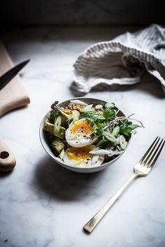 Farro bowl with avocado and eggs