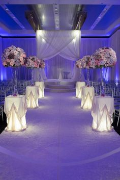 Romantic indoor purple wedding ceremony; Via Yanni Design Studio
