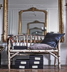 These images were taken from the IKEA Find It! book, showing off the Paris home of stylist, Hans Blomquist. Here, storage is placed under a rustic seat in a palatial hallway.